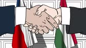politiker : Businessmen or politicians shake hands against flags of the Czech Republic and Hungary. Official meeting or cooperation related cartoon animation