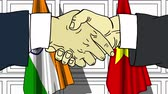 desenhado : Businessmen or politicians shake hands against flags of India and Vietnam. Official meeting or cooperation related cartoon animation