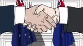 politiker : Businessmen or politicians shake hands against flags of Australia and New Zealand. Official meeting or cooperation related cartoon animation Stock Footage