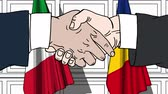 рукопожатие : Businessmen or politicians shake hands against flags of Italy and Romania. Official meeting or cooperation related cartoon animation