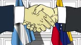 politiker : Businessmen or politicians shake hands against flags of Argentina and Venezuela. Official meeting or cooperation related cartoon animation