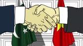 pakistan : Businessmen or politicians shake hands against flags of Pakistan and Vietnam. Official meeting or cooperation related cartoon animation