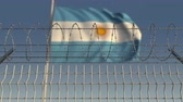 restringido : Barbed wire against waving flag of Argentina. Loopable 3D animation