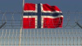 境界 : Barbed wire against waving flag of Norway. Loopable 3D animation