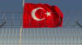 フロンティア : Barbed wire against waving flag of Turkey. Loopable 3D animation 動画素材