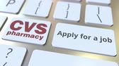 cv : CVS PHARMACY company logo and Apply for a job text on the keys of the computer keyboard, editorial conceptual animation Stock Footage