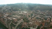 sloping : Aerial view of ancient Forte di Belvedere, Palazzo Pitti palace and riverfront houses in Florence, Italy