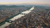 çatılar : Picturesque aerial shot of bridges over the Arno river in Florence, Italy Stok Video