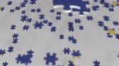 bilmece : Flag of the European Union EU being made with jigsaw puzzle pieces. Problem solution conceptual 3D animation