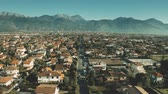 sloping : Low altitude aerial shot of villas and streets in Forte dei Marmi, Italy Stock Footage