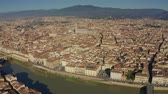 sloping : Aerial view of the Cathedral of Santa Maria del Fiore and Ponte Vecchio bridge in Florence, Italy Stock Footage