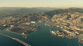 iate : Aerial of seaport and cityscape of Genoa in the evening. Italy Vídeos