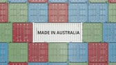 international economy : Cargo container with MADE IN AUSTRALIA text. Australian import or export related 3D animation