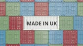английский : Cargo container with MADE IN UK text. British import or export related 3D animation