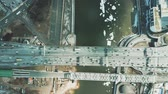 bridge across the river : Aerial top down view of car and railway bridges above icy river Stock Footage