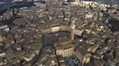 sloping : Aerial of Siena centre involving famous Piazza del Campo, one of Europes greatest medieval squares. Tuscany, Italy