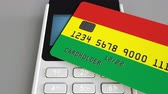 Боливия : Paying with bank card with flag of Bolivia. Bolivian retail sales or banking conceptual 3D animation