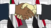 egyptisch : Businessmen or politicians shake hands against flags of Sudan and Egypt. Official meeting or cooperation related cartoon animation