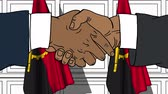 Businessmen or politicians shaking hands against flags of Angola. Meeting or cooperation related cartoon animation