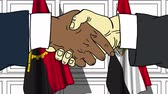 Businessmen or politicians shake hands against flags of Angola and Egypt. Official meeting or cooperation related cartoon animation