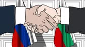 болгарский : Businessmen or politicians shake hands against flags of Russia and Bulgaria. Official meeting or cooperation related cartoon animation