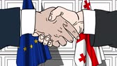 Businessmen or politicians shake hands against flags of EU and Georgia. Official meeting or cooperation related cartoon animation