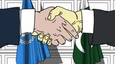 pakistan : Businessmen or politicians shake hands against flags of United Nations and Pakistan. Official meeting or cooperation related editorial animation