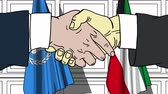 diplomat : Businessmen or politicians shake hands against flags of United Nations and Kuwait. Official meeting or cooperation related editorial animation