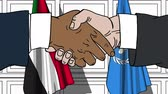 diplomat : Businessmen or politicians shake hands against flags of Sudan and United Nations. Official meeting or cooperation related editorial animation