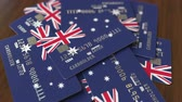 půjčka : Pile of credit cards with flag of Australia. Australian banking system conceptual 3D animation