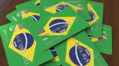 cardholder : Pile of credit cards with flag of Brazil. Brazilian banking system conceptual 3D animation Stock Footage