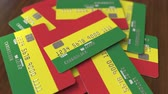 borç : Pile of credit cards with flag of Bolivia. Bolivian banking system conceptual 3D animation