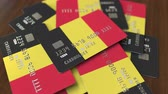 belga : Pile of credit cards with flag of Belgium. Belgian banking system conceptual 3D animation