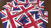 английский : Pile of credit cards with flag of the United Kingdom. British banking system conceptual 3D animation