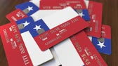 chilien : Pile of credit cards with flag of Chile. Chilean banking system conceptual 3D animation Vidéos Libres De Droits