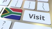 overseas : VISIT text and flag of South Africa on the buttons on the computer keyboard. Conceptual 3D animation