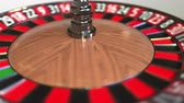 olasılık : Casino roulette wheel ball hits 3 three red. 3D animation Stok Video