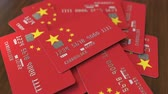 cardholder : Pile of credit cards with flag of China. Chinese banking system conceptual 3D animation Stock Footage