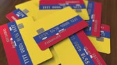 cardholder : Pile of credit cards with flag of Colombia. Colombian banking system conceptual 3D animation