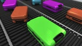 manuseio : Colorful suitcases move on roller conveyor in the airport. Loopable 3D animation