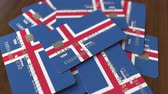 cardholder : Pile of credit cards with flag of Iceland. Icelandic banking system conceptual 3D animation