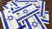 figyelembe : Pile of credit cards with flag of Israel. Israeli banking system conceptual 3D animation