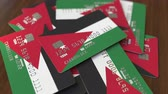 jordanian : Pile of credit cards with flag of Jordan. Jordanian banking system conceptual 3D animation