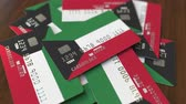 cardholder : Pile of credit cards with flag of Kuwait. Kuwaiti banking system conceptual 3D animation