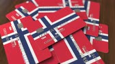 норвежский : Pile of credit cards with flag of Norway. Norwegian banking system conceptual 3D animation