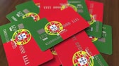 portugalia : Pile of credit cards with flag of Portugal. Portuguese banking system conceptual 3D animation Wideo