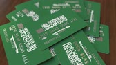 wizytówka : Pile of credit cards with flag of Saudi Arabia. National banking system conceptual 3D animation Wideo