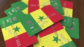 senegal : Pile of credit cards with flag of Senegal. Senegalese banking system conceptual 3D animation