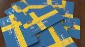 шведский : Pile of credit cards with flag of Sweden. Swedish banking system conceptual 3D animation