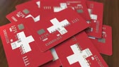 borç : Pile of credit cards with flag of Switzerland. Swiss banking system conceptual 3D animation Stok Video
